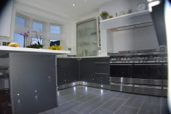 modern kicthen with large double oven and floor lights